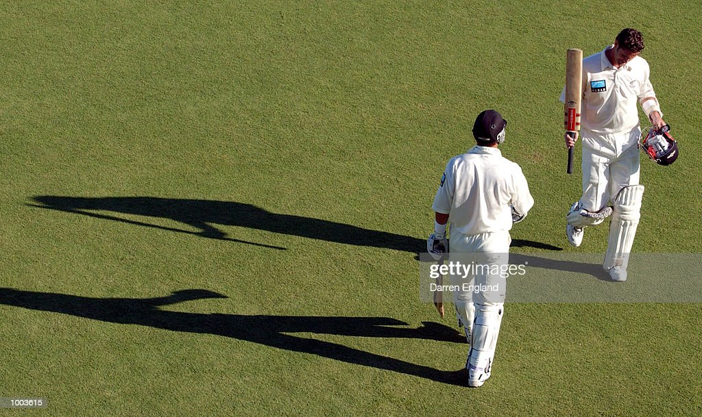 Chris Cairns of New Zealand leaves the field after retiring not out on 119 as teammate Adam Parore goes out to bat against the Queensland Academy of Sport during the tour match at Allan Border Field in Brisbane, Australia. DIGITAL IMAGE. Mandatory Credit: Darren England/ALLSPORT