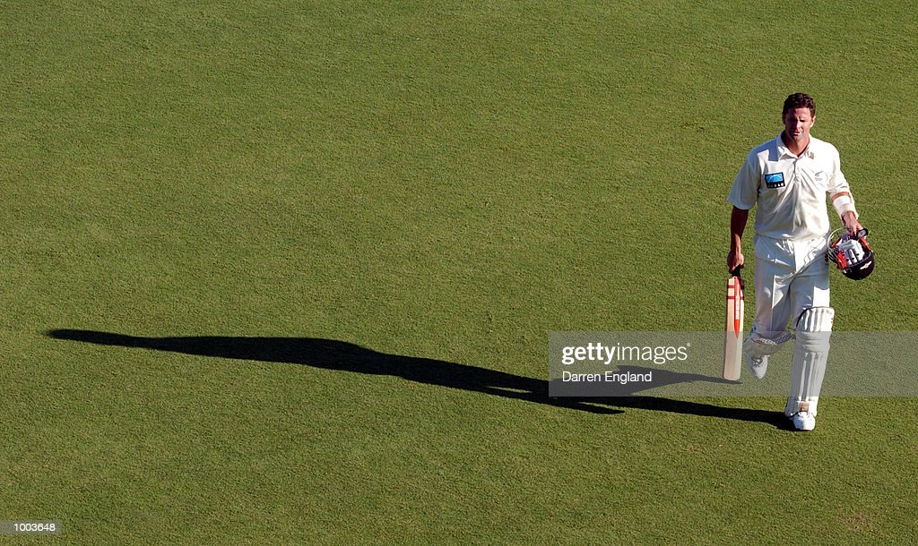 Chris Cairns of New Zealand leaves the field after retiring not out on 119 against Queensland during the New Zealand cricket teams tour match against the Queensland Academy of Sport at Allan Border...