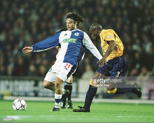 Corrado Grabbi of Blackburn Rovers is put under pressure by Frank Sinclair of Leicester City during the FA Barclaycard Premiership game between...