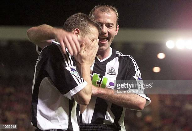 Craig Bellamy of Newcastle celebrates scoring with Alan Shearer during the Worthington Cup game between Barnsley and Newcastle United at Oakwell in...