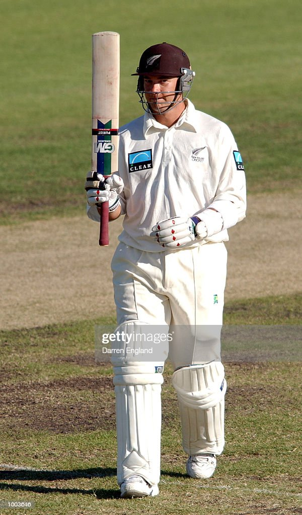 Craig McMillan of New Zealand celebrates scoring a century against Queensland during the New Zealand cricket teams tour match against the Queensland Academy of Sport at Allan Border Field in Brisba...
