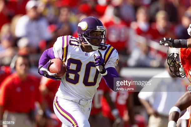 Cris Carter of the Minnesota Vikings carries the ball against the Tampa Bay Buccaneers during the game at Raymond James Stadium in Tampa Florida The...