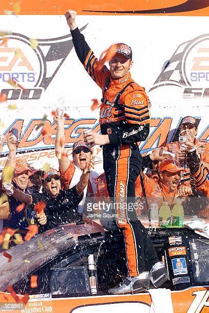 Dale Earnhardt Jr celebrates in Victory Lane after winning Sunday's EA Sports 500 at Talladega Superspeedway in Talladega Alabama Digital Image...