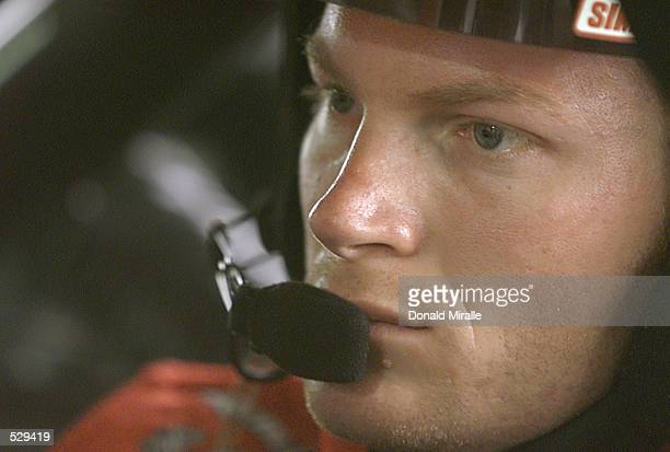 Dale Earnhardt Jr driver of the Earnhardt Enterprises Chevrolet Monte Carlo looks on during the practice session of the Old Dominion 500 at...