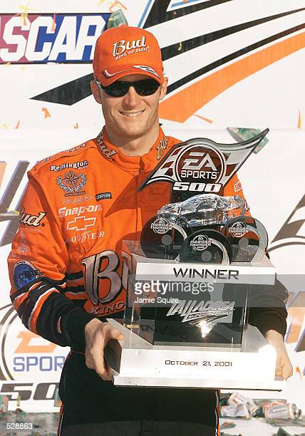 Dale Earnhardt Jr poses with the trophy in Victory Lane after winning Sunday's EA Sports 500 at Talladega Superspeedway in Talladega Alabama Digital...
