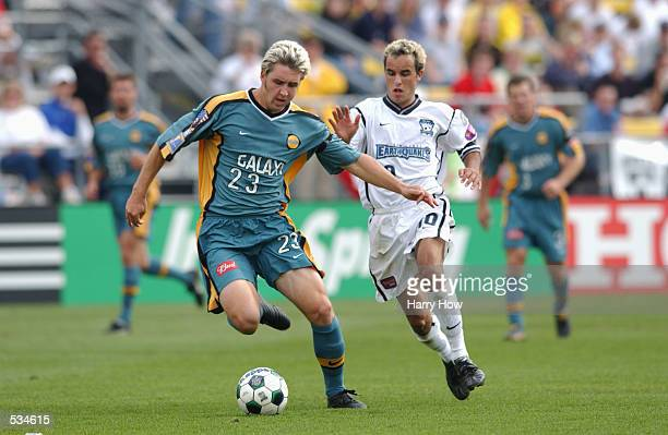 Dan Califf of the Los Angeles Galaxy controls the ball past Landon Donovan of the San Jose Earthquakes during the Major League Soccer Cup in Columbus...