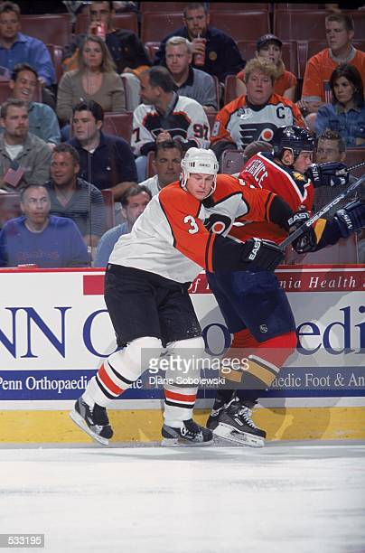Dan McGillis of the Philadelphia Flyers hip checks Brad Ference of the Florida Panthers during the game at First Union Center in Philadelphia...