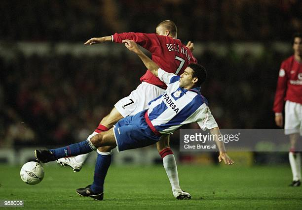 David Beckham of Man Utd tangles with Deportivo's Nourredine Naybet during the UEFA Champions League match between Manchester United and Deportivo La...