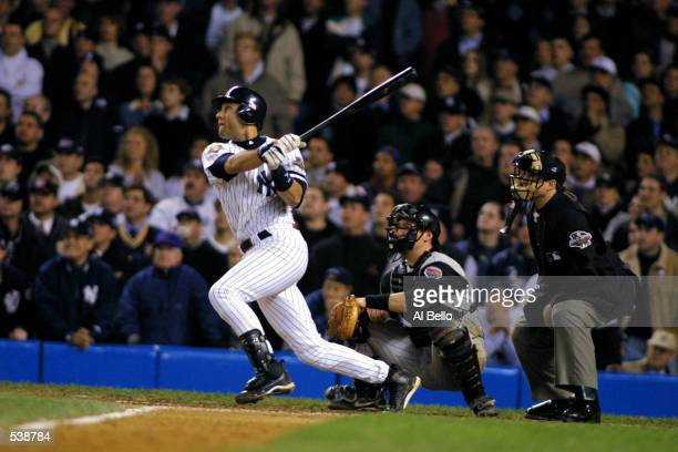 Derek Jeter of the New York Yankees swats the game winning home run in the 10th inning against the Arizona Diamondbacks during game four of the Major...