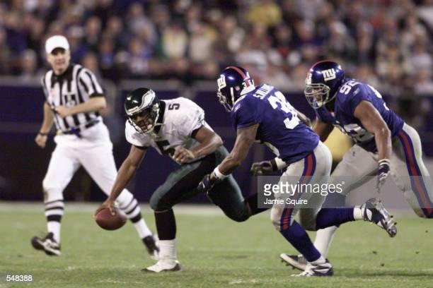 Donavan McNabb of the Philadelphia Eagles tries to elude Shaun Williams of the New York Giants during the game between the Philadelphia Eagles and...