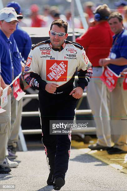 Driver Tony Stewart jogs to the track during the EA Sports 500 part of the NASCAR Winston Cup Championship Series at Talladega Superspeedway in...