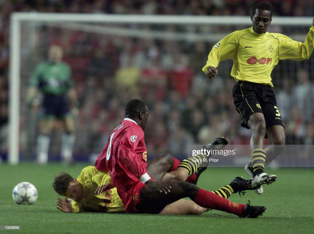 Emile Heskey of Liverpool falls as Evanilson of Borussia Dortmund attempts a tackle during the UEFA Champions League match between Liverpool and Borussia Dortmund at Anfield, Liverpool. DIGITAL IMAGE. Mandatory Credit: Gary M. Prior/ALLSPORT