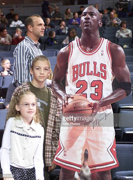 Fans pose next to a Michael Jordan life-size cut-out before the pre-season game between the Washington Wizards and the Detroit Pistons at Van Andel...