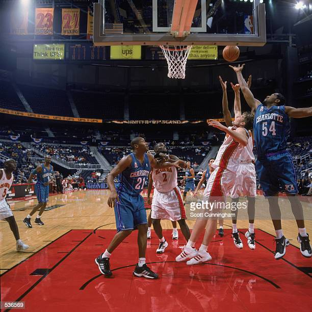 Forward Lee Nailon of the Charlotte Hornets jumps for the rebound over forward Hanno Mottola of the Atlanta Hawks during the preseason game at...