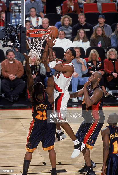 Forward Scottie Pippen of the Portland Trailblazers battles forward Danny Fortson of the Golden State Warriors for a rebound during the NBA game at...
