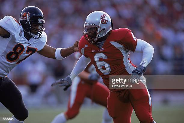 Fred Shavies of the Washington State Cougars moves on the field as he is guarded by Jermaine Jackson of the Oregon State Beavers during the game at...
