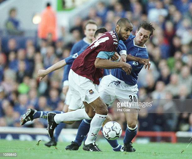 Frederic Kanoute of West Ham is tackled by Martijn Reuser of Ipswich during the FA Barclaycard Premiership match between Ipswich Town and West Ham...