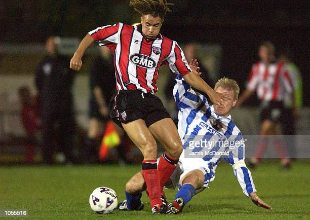 Gavin Mahon of Brentford is tackled by Paul Rogers of Brighton during the Nationwide Division Two game between Brighton and Hove Albion v Brentford...