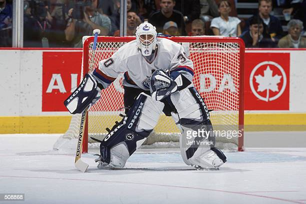 Goaltender Martin Brochu of the Vancouver Canucks guards the goal during the game against the Toronto Maple Leafs at the GM Place in Vancouver Canada...