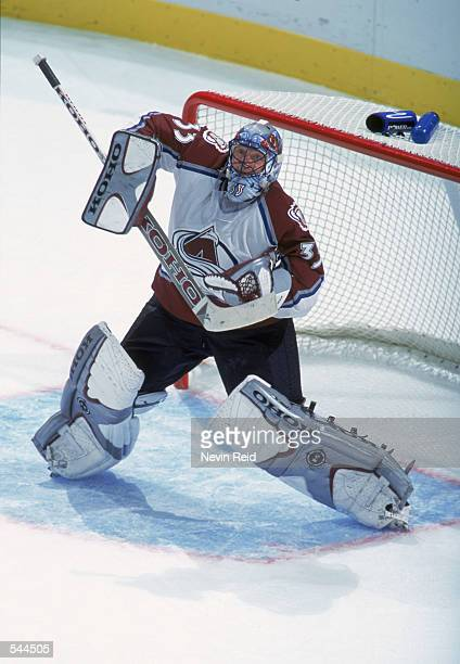 Goaltender Patrick Roy of the Colorado Avalanche makes a save during the NHL game against the Tampa Bay Lightning at the Pepsi Center in Denver...