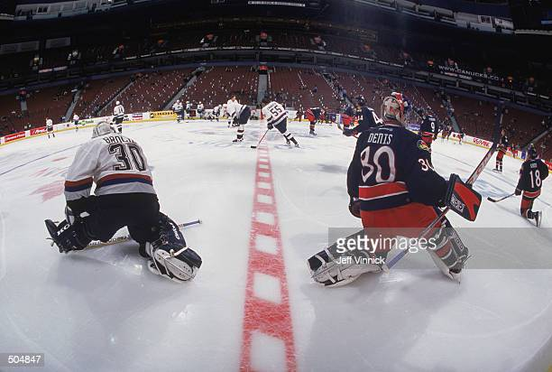 Goaltenders Marc Denis of the Columbus Blue Jackets and Martin Brochu of the Vancouver Canucks strech their legs before the NHL game at GM Place in...