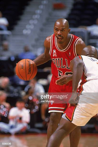 Guard Greg Anthony of the Chicago Bulls dribbles the ball during the preseason game against the Atlanta Hawks at Phillips Arena in Atlanta Georgia...