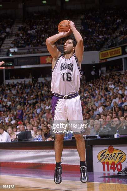 Guard Pedrag Stojakovic of the Sacramento Kings shoots an outside jump shot during the preseason game against the Memphis Grizzlies at Arco Arena in...