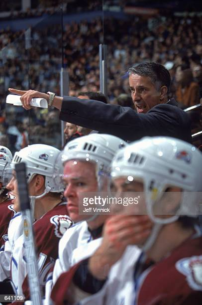 Head Coach Bob Hartley of the Colorado Avalanche yells from the bench during the game against the Vancouver Canucks at the GM Palace in Vancouver...