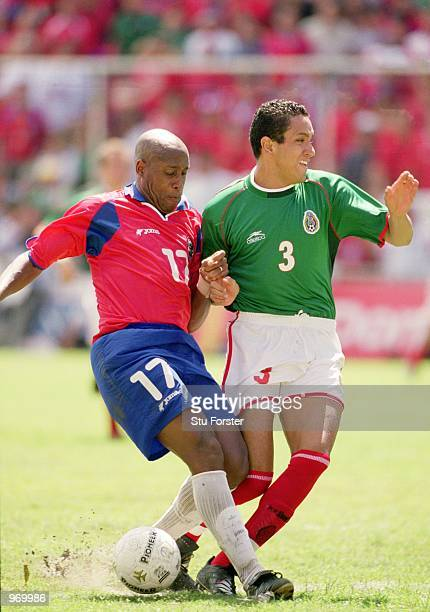 Hernan Medford of Costa Rica and Ramon Morales of Mexico challenge for the ball during the FIFA 2002 World Cup Qualifier between Costa Rica and...