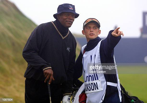 Hollywood film star Samuel L Jackson receives advise from his caddie during the weather delayed second round of the inaugural US$5000 Dunhill Links...
