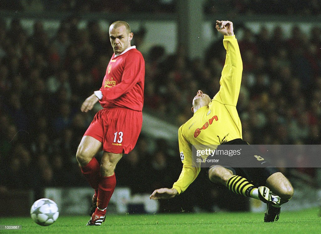 Jan Koller of Borussia Dortmund goes to ground with Danny Murphy of Liverpool in attendance during the UEFA Champions League match between Liverpool and Borussia Dortmund at Anfield, Liverpool. Mandatory Credit: Stu Forster/ALLSPORT