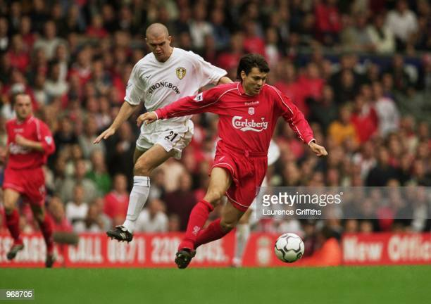 Jari Litmanen of Liverpool takes the ball past Dominic Matteo of Leeds United during the FA Barclaycard Premiership match played at Anfield in...
