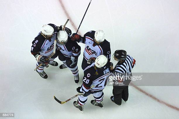 Jenny Potter AJ Mleczko Katie King and Angela Ruggiero of the USA speak with the referee after a goal during an exhibition game against Canada at the...