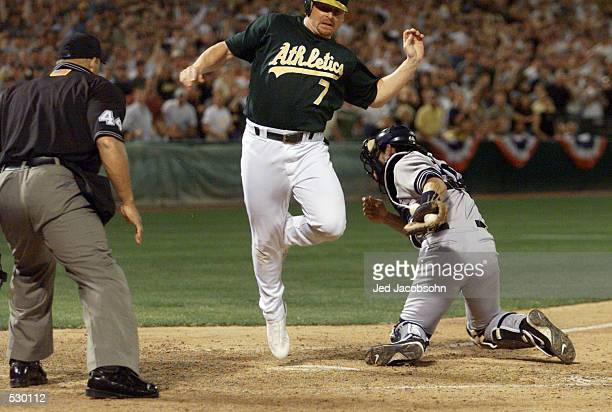 Jeremy Giambi of the Oakland A's is tagged out by Jorge Posada of the New York Yankees during game three of the American League Divisional Series at...
