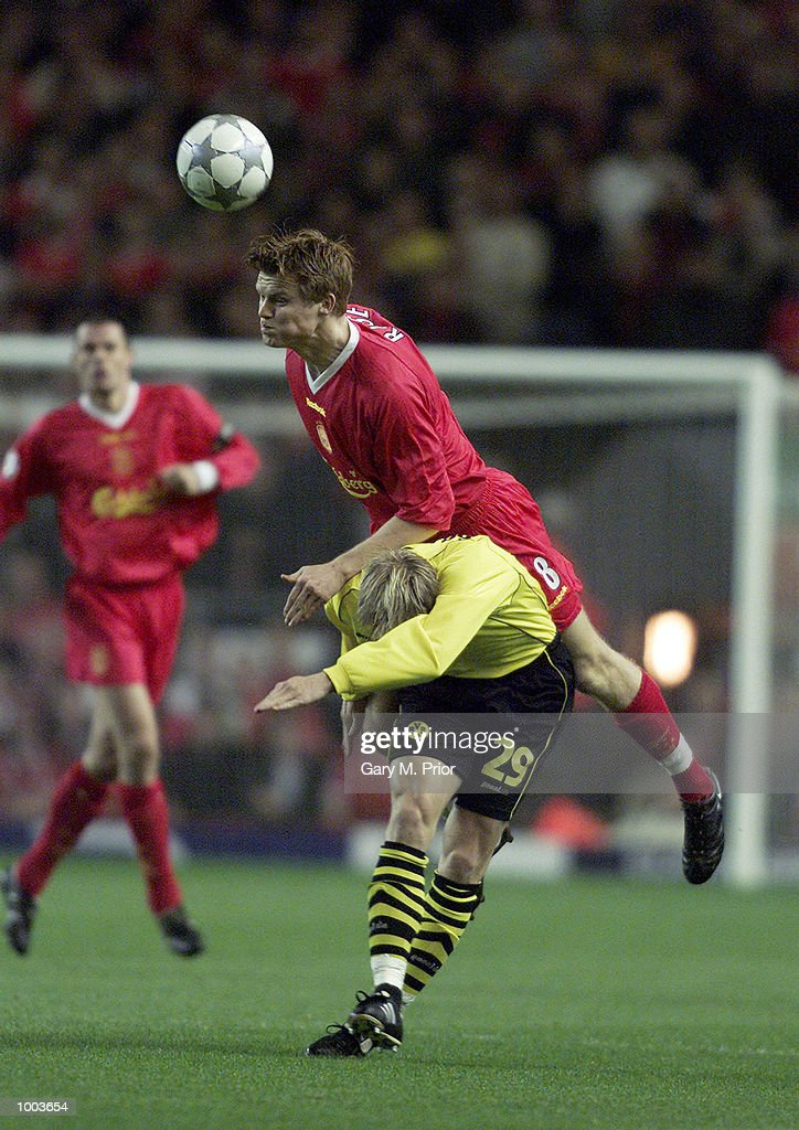 John Arne Riise of Liverpool heads the ball away from Jan Derek Sorensen of Borussia Dortmund during the UEFA Champions League match between Liverpool and Borussia Dortmund at Anfield, Liverpool. DIGITAL IMAGE Mandatory Credit: Gary M. Prior/ALLSPORT