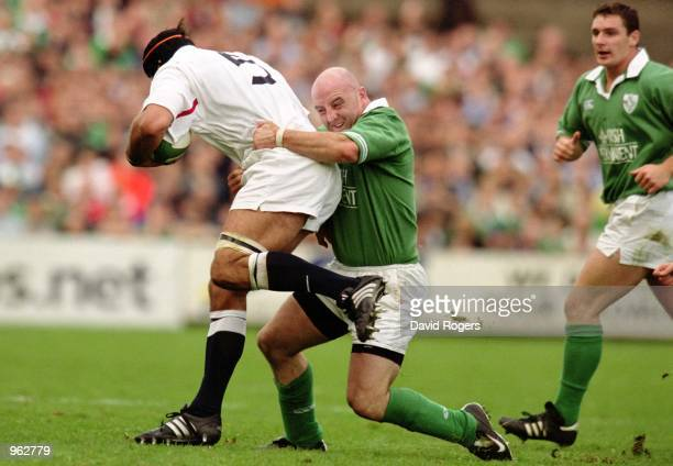 Keith Wood of Ireland tackles Danny Grewcock of England during the Lloyds TSB Six Nations Championship match played at Lansdowne Road in Dublin...