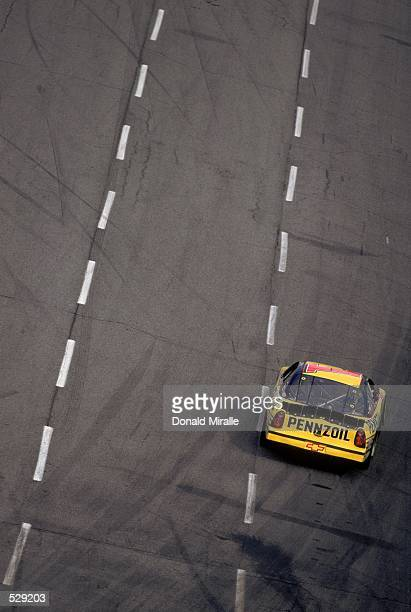 Kenny Wallace pulls out of a turn during the Old Dominion 500 part of the NASCAR Winston Cup Series at the Martinsville Speedway in Martinsville...