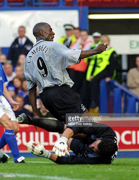 Kevin Campbell captain of Everton is brought down by Matteo Sereni of Ipswich in the FA Barclaycard Premiership match at Portman Road Ipswich The...