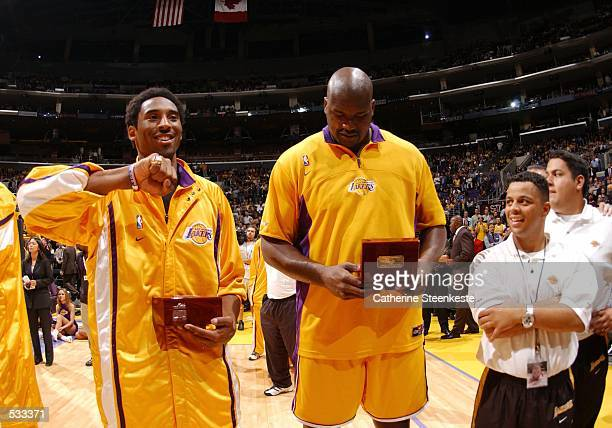 Kobe Bryant and Shaquille O''Neal of the Los Angeles Lakers look at their Championship ring before the game against the Portland Trailblazers at...