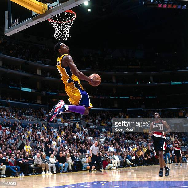 Kobe Bryant of the Los Angeles Lakers soars in for a dunk against the Portland Trail Blazers during the NBA game at Staples Center in Los Angeles...