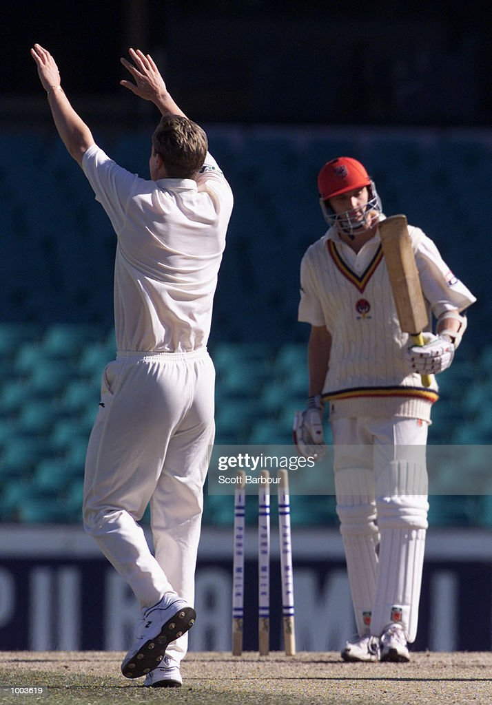 Last man out Mark Harrity of South Australia looks at his bat after being bowled by Nathan Bracken of New South Wales during Day 3 of the Pura Cup match at the Sydney Cricket Ground in Sydney, Australia. DIGITAL IMAGE. Mandatory Credit: Scott Barbour/ALLSPORT