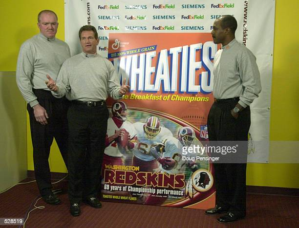 left to right Former Washington Redskins Joe Jacoby Joe THeismann and Art Monk unviel the first of two new Wheaties boxes commemorating the rivalry...