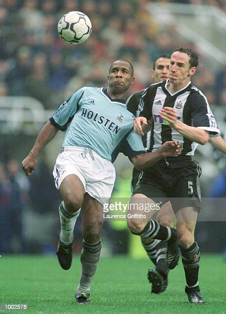 Les Ferdinand of Spurs clashes with Andrew O''Brien of Newcastle during the Newcastle United v Tottenham Hotspur FA Barclaycard Premiership match at...