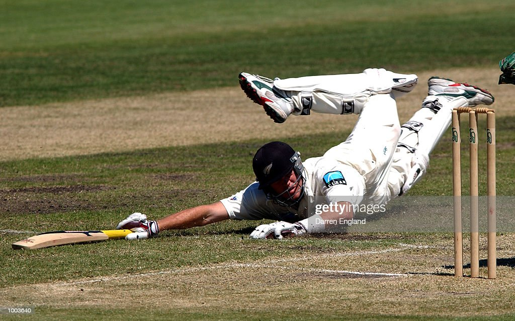 Lou Vincent of New Zealand dives for the crease to survive a run out attempt on his way to making 136 runs against Queensland during the New Zealand cricket teams tour match against the Queensland Academy of Sport at Allan Border Field in Brisbane, Australia. DIGITAL IMAGE. Mandatory Credit: Darren England/ALLSPORT