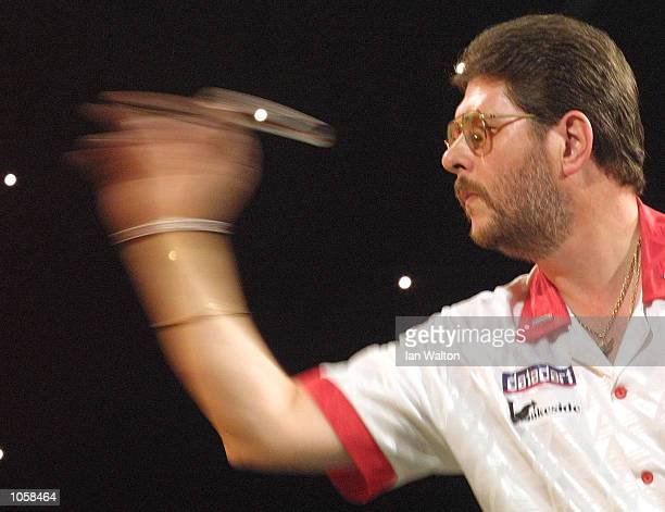 Martin Adams of England in action against Alex Roy of England during the Second Round in the Professional Darts Corporation and Paddy Power World...
