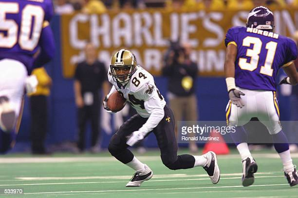 Michael Lewis of the New Orleans Saints runs with the ball during the game against the Minnesota Vikings at the Superdome in New Orleans Louisiana...