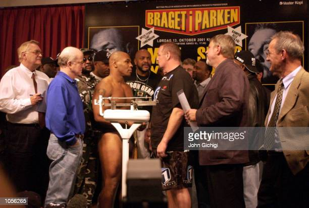 Mike Tyson of the USA and Brian Nielsen of Denmark go head to head during the weighin ahead of their fight on Saturday 13th Oct in Copenhagen Denmark...