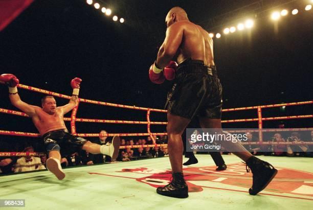 Mike Tyson of the USA knocks down opponent Brian Nielsen of Denmark during the world heavyweight fight at the Parken Stadium in Copenhagen, Denmark....