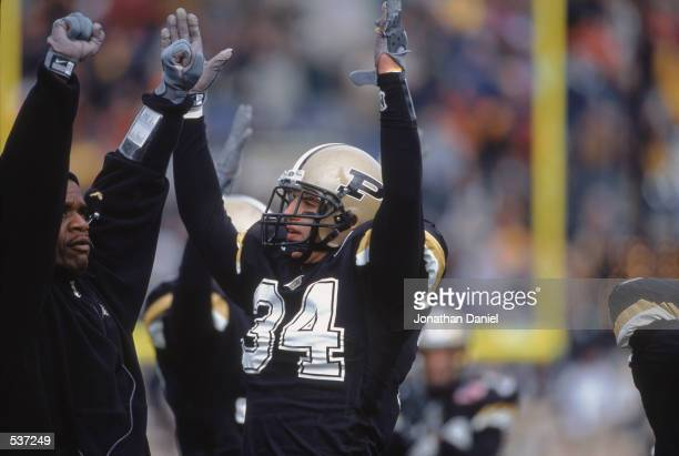 Niko Koutouvides of the Purdue Boilermakers signals the touch down from the sidelines during the game against the Northwestern Wildcats at Ross-Ade...