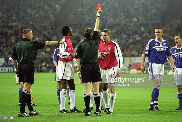 Oleg Luzhny of Arsenal is sentoff during the UEFA Champions League Group C match against FC Schalke 04 played at the Arena AufSchalke in...